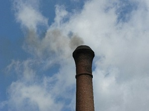 smokestack emitting smoke into the air