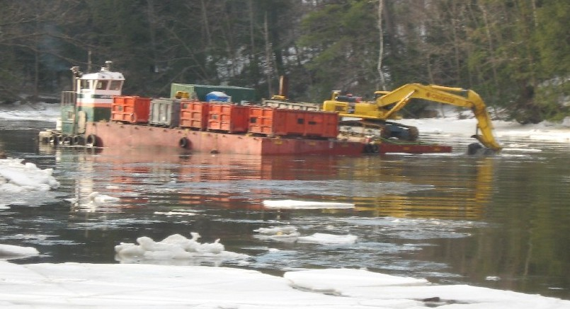 mechanical dredging from a barge in the Cocheco River