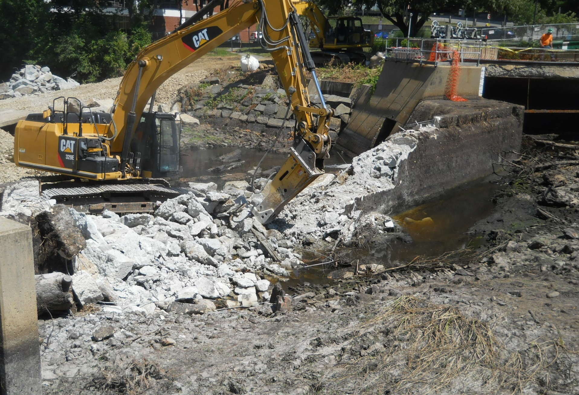 excavator removing great dam in exeter.