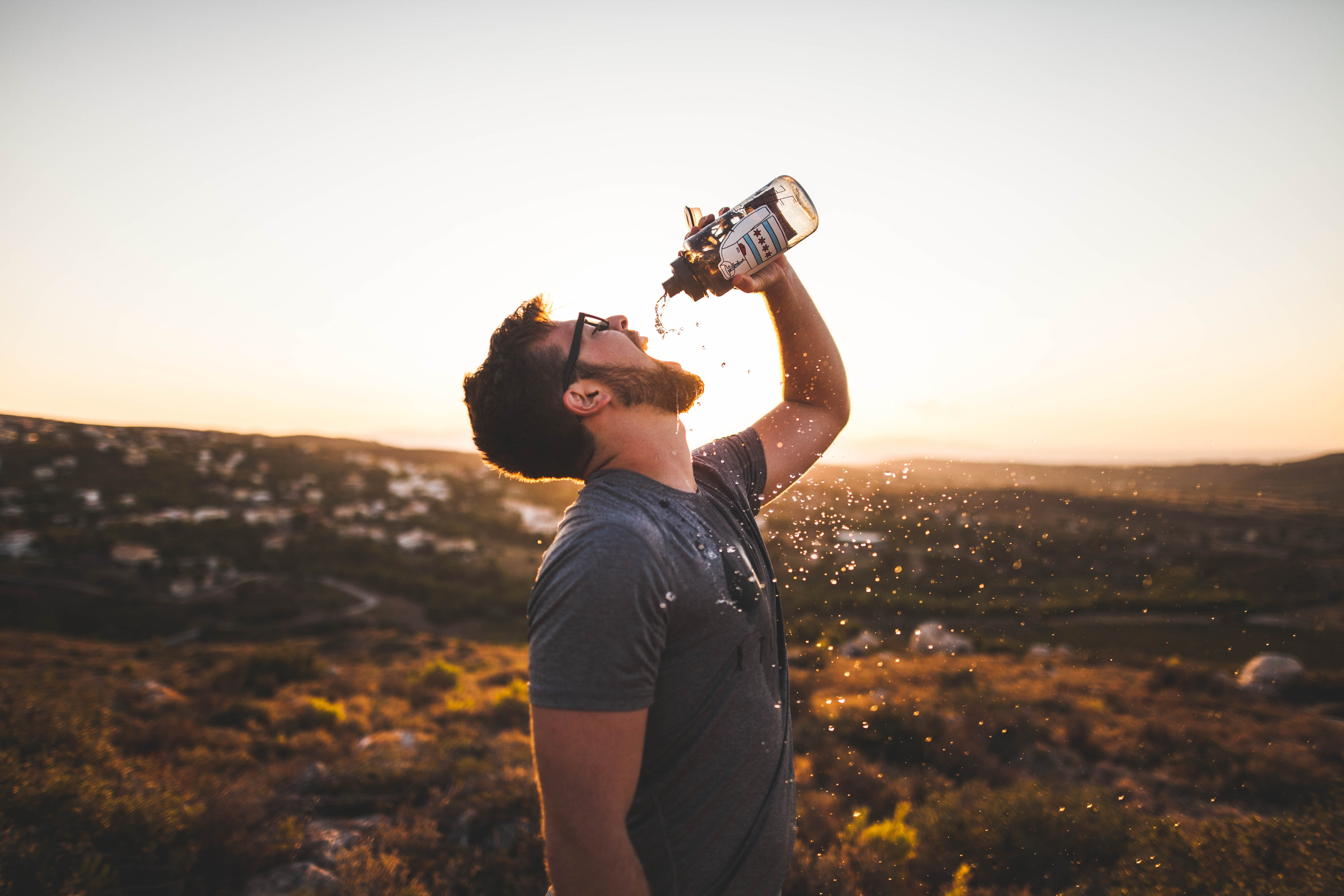an image of a man drinking from a water bottle
