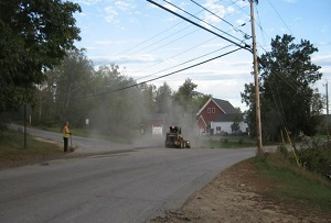 Road work causes dust to fill the air.